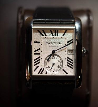 The blue hands and black Roman numerals hour markers are the iconic features of Cartier.