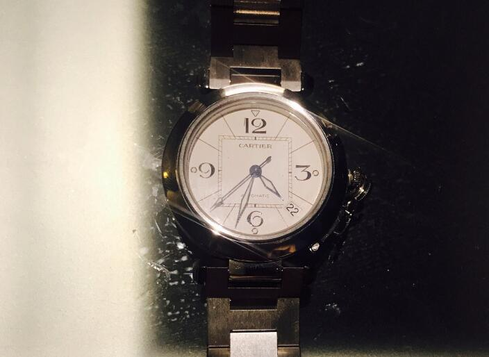 The hour markers are marked as Arabic numerals, which is quite different from modern Cartier.